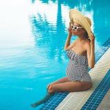 Beautiful pregnant woman in swimming pool royalty free stock photo