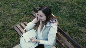 Beautiful pregnant woman takes from the backpack the phone and answers the call. stock footage