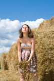 Beautiful Pregnant Woman takes Fun near Haystack Stock Images