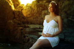 Beautiful pregnant woman touching her belly. Outdoor Royalty Free Stock Photography