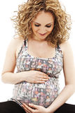 Beautiful pregnant woman touching her lovely belly Stock Images