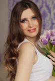 Beautiful pregnant woman with tulips waiting a Stock Photography