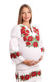 Beautiful pregnant woman in Ukrainian style dress Royalty Free Stock Photography