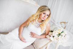 Beautiful pregnant woman in waiting for the baby. Pregnancy. Care, tenderness, maternity, childbirth. Beautiful pregnant woman in waiting for the baby royalty free stock photo