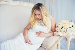 Beautiful pregnant woman in waiting for the baby. Pregnancy. Care, tenderness, maternity, childbirth. Royalty Free Stock Images