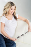 Beautiful pregnant woman watching her ultrasound scans Stock Image