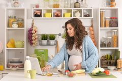 Beautiful Pregnant Woman With Food Stock Photo