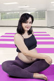 Beautiful pregnant woman workout at gym Stock Image