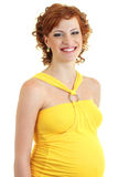 Beautiful pregnant woman in yellow Royalty Free Stock Image