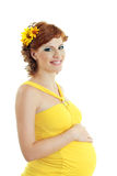 Beautiful pregnant woman in yellow Royalty Free Stock Photo