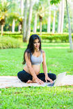 Beautiful pregnant woman yoga with laptop. In the park Royalty Free Stock Photos