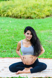 Beautiful pregnant woman yoga. In the park Royalty Free Stock Image