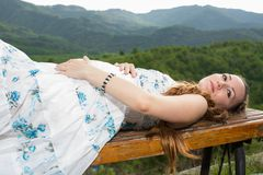 Beautiful pregnant womanmeditating and relax on nature Stock Image