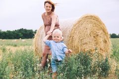 Pregnant woman and son on nature. Mother waiting of a second bab Royalty Free Stock Image