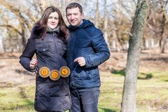 Beautiful pregnant woman and her handsome husband royalty free stock photography