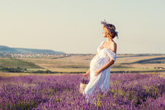 Beautiful pregnant young woman in a white dress Royalty Free Stock Photography