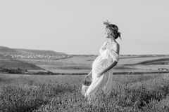 Beautiful pregnant young woman in a white dress Stock Images
