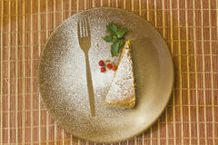 Beautiful prepared breakfast - cake, mint on brown plate Royalty Free Stock Photos