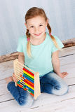 Beautiful preschool child with abacus Royalty Free Stock Images
