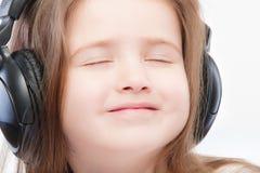 Beautiful Preschool Child In Headphones Stock Photo