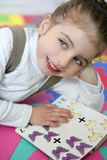 Beautiful preschooler girl studying book Royalty Free Stock Image