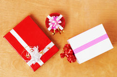 Beautiful presents  in the table. Beautiful presents  in the wood table Stock Photography