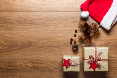 Beautiful presents, xmas concept, desk with santa hat, view from above. With copy space Stock Photos