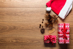Beautiful presents, xmas concept, desk with santa hat, view from above. With copy space Royalty Free Stock Photography