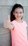Beautiful preteen girl with blue eyes saying Ok Stock Photo