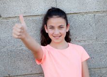 Beautiful preteen girl with blue eyes saying Ok Royalty Free Stock Photography