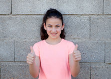 Beautiful preteen girl with blue eyes saying Ok Stock Photography