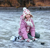 Beautiful preteen girl figure skating in open winter skating rin Royalty Free Stock Photo