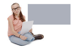 Beautiful preteen girl with a tablet computer. Royalty Free Stock Photography