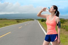 Beautiful pretty female jogger completed running Royalty Free Stock Photos
