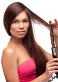 Beautiful pretty girl doing hairstyle Royalty Free Stock Photos