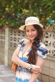 Beautiful pretty girl posing in hat on summer Stock Image