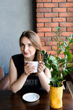 Beautiful Pretty Happy Young Woman drinking coffee. Royalty Free Stock Images