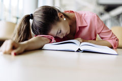 Beautiful pretty woman fallen asleep while studying Stock Photos