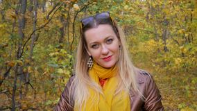 Beautiful Pretty Woman in Forest on Background of Yellow Foliage in Autumn stock video footage
