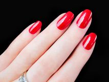 Beautiful pretty womans hand fingers red fingernails nails stock photo