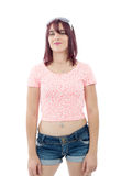 Beautiful pretty young woman in pink shirt and shorts Royalty Free Stock Image