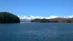 Prince William Sound Alaska by boat. Beautiful Prince William Sound Alaska by boat, mountains, trees, water, and snow stock video footage