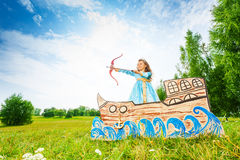 Beautiful princess with bow, arrow start shooting royalty free stock photography