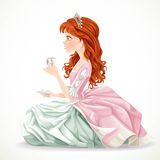 Beautiful princess with brown hair sitting on the floor with tea Royalty Free Stock Photography