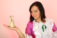 Beautiful princess with crown over pink background Royalty Free Stock Images