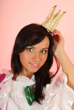 Beautiful princess with crown over pink background Stock Photography