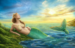 Beautiful princess- fantasy mermaid at sunset background. The beautiful princess the mermaid at sunset, on the seashore.landscape painting Stock Photo
