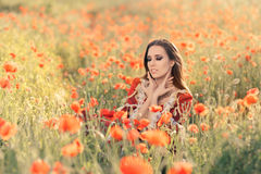 Beautiful Princess in a Field of Poppies Royalty Free Stock Photography