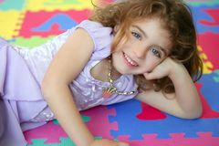 Beautiful princess little girl smiling lying floor Royalty Free Stock Photo