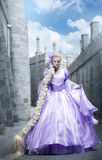 The beautiful princess with a long plait. At an old palace Royalty Free Stock Image